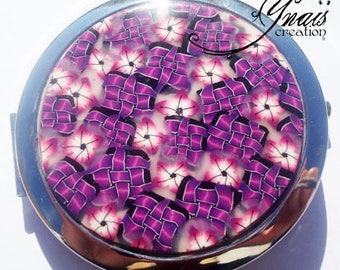 round Pocket mirror has purple flowers Fimo