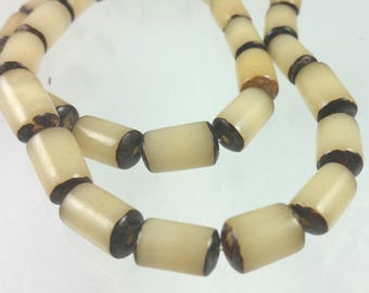 Buri 8x13mm beads, 16 inch strand, 32 beads