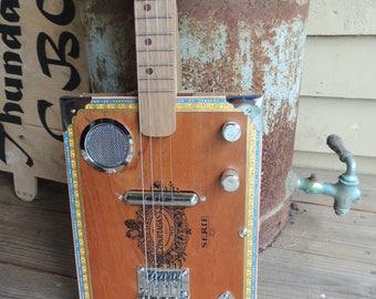Custom 4 string cigar box guitar.