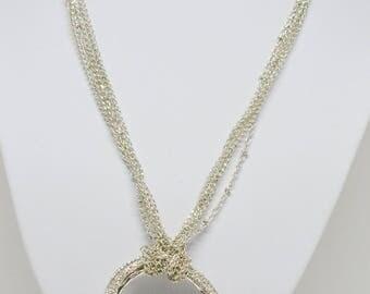 Lovely multi strand silver tone necklace
