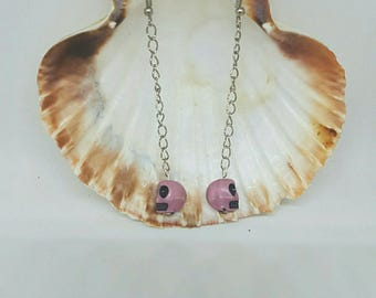 Chain and skull earrings