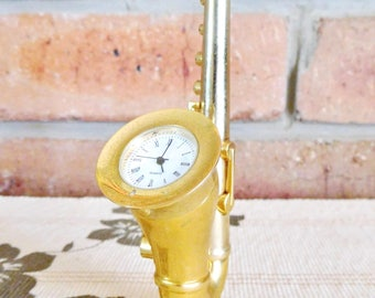 Miniature lacquered brass saxophone novelty clock, vintage 1990s, movie prop, collectable