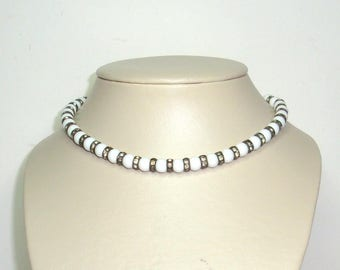 """White milk glass beaded necklace with alternating rings of channel set rhinestones. Choker adjustable, 14"""" to16"""" strung on silver tone chain"""