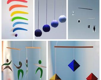 Set of 5 Montessori Mobiles. Munari. Blue Gobbi mobile. The Dancers Mobile. The octahedron Mobile. The Rainbow mobile. Classic montessori.