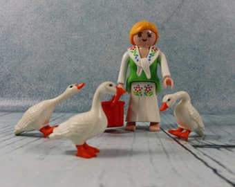Vintage Playmobil lady feeding Geese