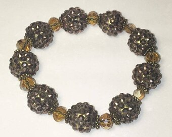 Gold stretch bracelet with light gold accent beads. Stretchy One Size
