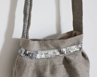 Small purse from linen and silver glitter band
