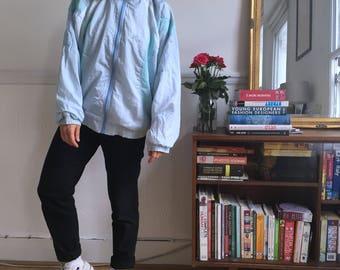 Vintage windbreaker jacket in baby  blue. Size M  UK size 10/12. Late 80's early  90's era.