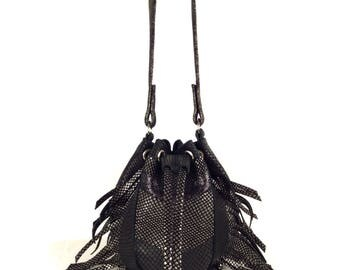 Glittery and black leather snake printed bucket bag