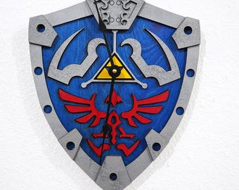 Zelda Wall Clock - Link's Hylian Shield / Laser cut and laser engraved wall clock. Perfect gift, memorabilia or collectible