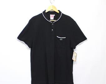 Vintage Clothing •1990's Menswear •Black Lacoste Polo • Peter Pan Round Collar •White Trim • Chest Pocket • 100% Cotton