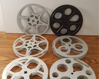 """6 Vintage 7"""" Diameter 8mm Movie Reels and 5 Storage Cans (c. 1960)"""