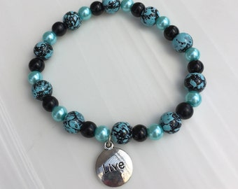 "Teal and black beaded charm (""Live"") bracelet"