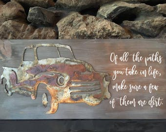 Hand painted wood sign with rusted metal old truck.