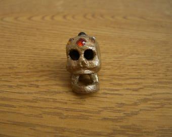 Miniature golden jewel encrusted mahogany skull