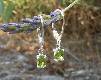 Peridot: August birth stone. Stud earring, 925 sterling silver, oval cut Peridot faceted 6 x 4 mm, gift for her.