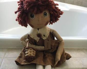 Rag Doll - Red Yarn Hair, Green Eyes Holding a Basket With Name Tag and Dress