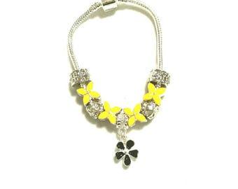 European bracelet with yellow European beads, black flower