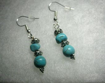 Genuine turquoise french hook earrings.