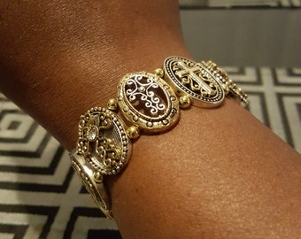 Silver and gold cross bracelet