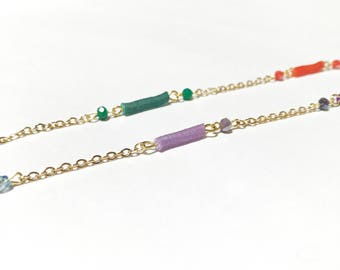 Long necklace with golden chain, sequins and jais of colored glass
