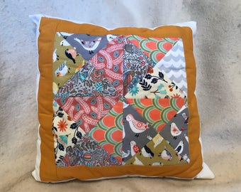 Birds and flowers throw pillow in gold