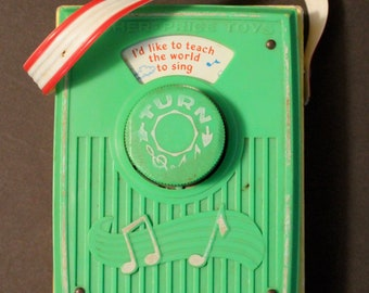 Vintage Fisher Price  #766  Pocket Wind Up Radio Music Box plays I'd Like to Teach the World to Sing