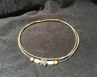 7 1/2 - Unique guitar strings bracelet decorated with beads