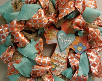 "12"" teal and orange wreath  layered with burlap, ribbons and a cross sign"