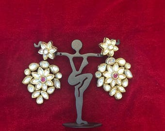 Kundan hanging earrings with a red ruby stone in the middle