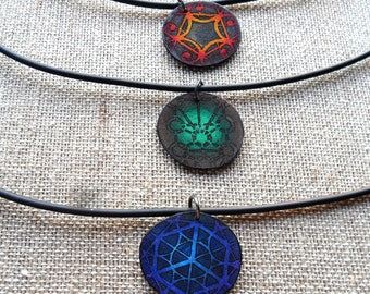 Sacred Geometry necklaces, mixed media necklaces on shrink plastic with rubber cording