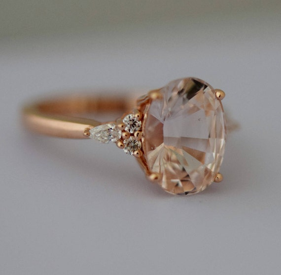 Peach sapphire engagement ring. Light peach sapphire 3.95ct oval diamond ring 14k Rose gold. Campari Engagement ring by  Eidelprecious
