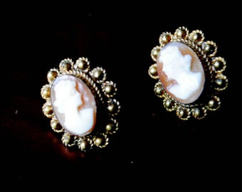 Victorian style  vintage 30 s, gold tone metal,screw back earrings with a  hand crafted cameo cabochon.