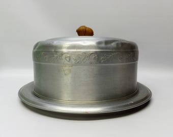 Vintage aluminum cake keeper with acorn detail