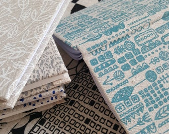 Pocket sized hardback notebooks and sketchbooks in screen printed fabric by Lucie Summers. Great stocking filler!