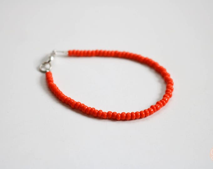 Skinny Orange Seed Bead Bracelet.