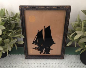 Vintage Nautical Sailboat Silhouette Art in Rustic Distressed Chippy Black Frame. Full Moon, Ocean Reflection. Brown, Black Scherenschnitte.