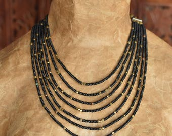 Multi Strand matte Black Seed Beads and Brass Bead Necklace