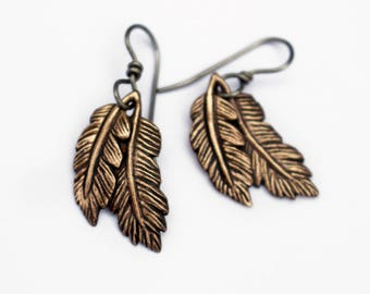 Titanium and bronze dangling feather earrings