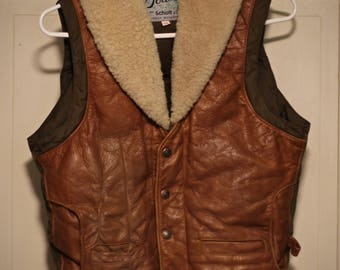Beautiful vintage Schott USA trapper's vest - Sheep wool lined, down filed, and leather construction - Tagged a vintage 34, fits as a Small