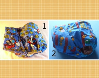 SassyCloth one size pocket diaper with Super Mario cotton print. Made to order.
