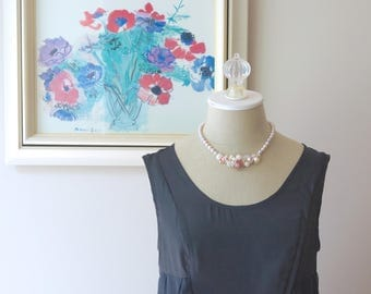 Real pearl necklace with gemstones