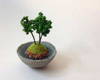 Wooded island in a tiny concrete bowl, miniature landscape, tiny decor