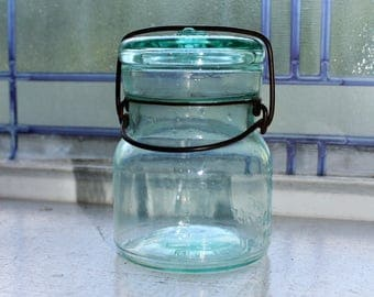 Antique Half Pint Blue Putnam Lightning Mason Jar with Glass Lid