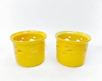 Two yellow flower pots