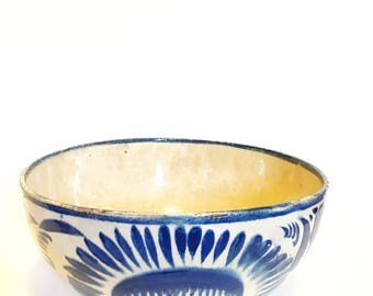 Antique off white bowl with blue hand painted design