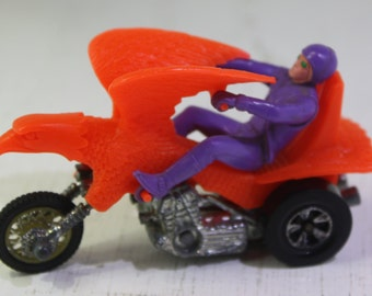 Scarce Mattel Rrrumblers Orange Bold Eagle motorcyle with purple rider.