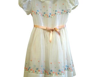Embroidered toddler dress in sheer white cotton batiste, gathered skirt, puff sleeves