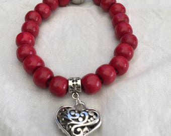 Red beaded bracelet with silver heart charm