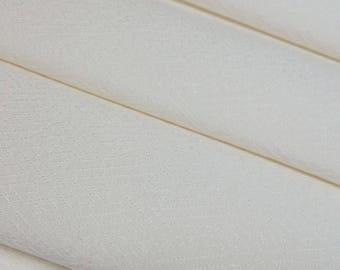 Off-white colored silk rinzu damask kimono fabric with woven sayagata key fret pattern - by the yard